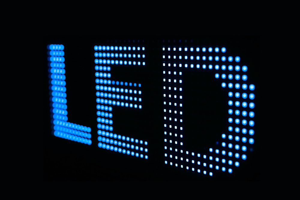 Blue LED sign at the LED smd screen - close up background
