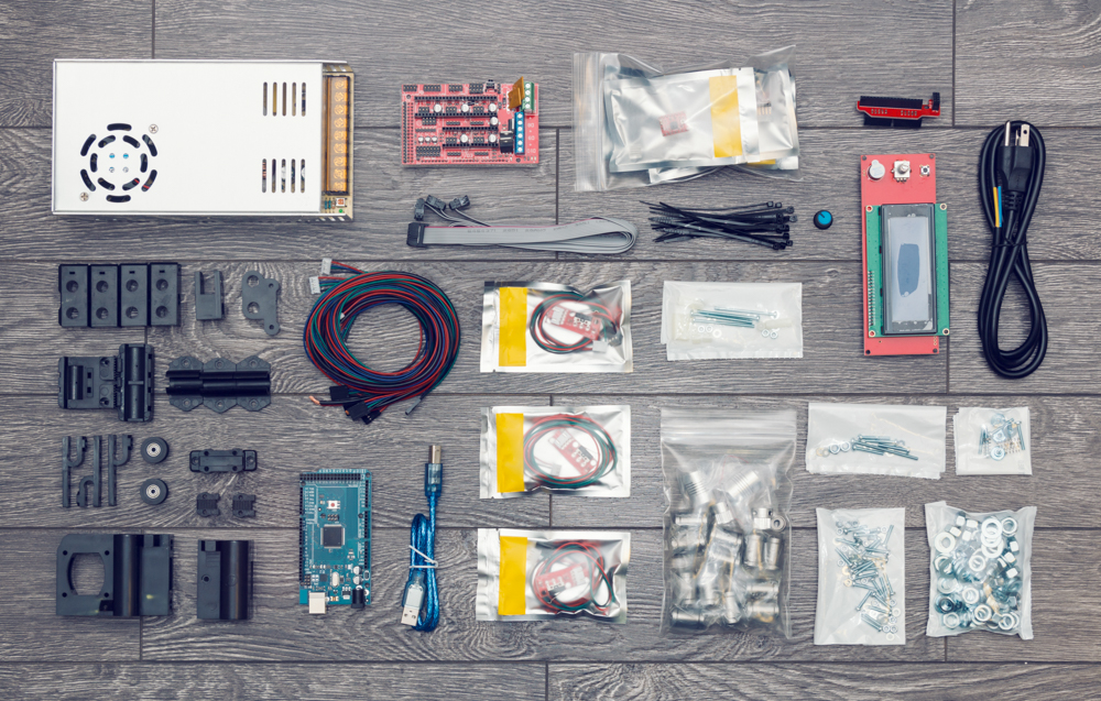 Flat lay of electronic and mechanical parts and components of DIY device on wooden surface